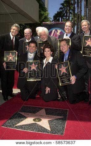 Jay Osmond, Merrill Osmond, Vernon Osmond, Andy Williams, Jimmy Osmond, Alan Osmond, Wayne Osmond, Tom Osmond, Johnny Grant, Donny Osmond, Marie Osmond, Leron Gubler at the Hollywood Walk of Fame, CA 08-07-03