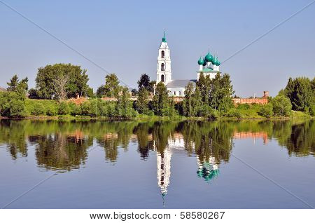 Cathedral With Bell Tower And His Reflection In Water