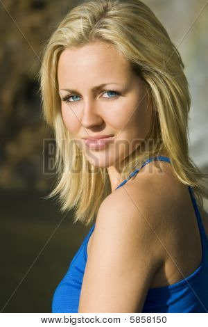 Beautiful Blond Woman In Blue Dress Bathed In Golden Sunshine