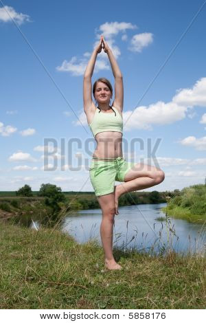 Fit Girl In Green Practicing Yoga