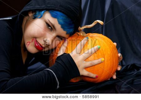 Young Halloween Vampire Girl With Pumpkin