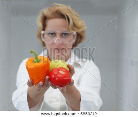 Female Scientist Offering Natural Food