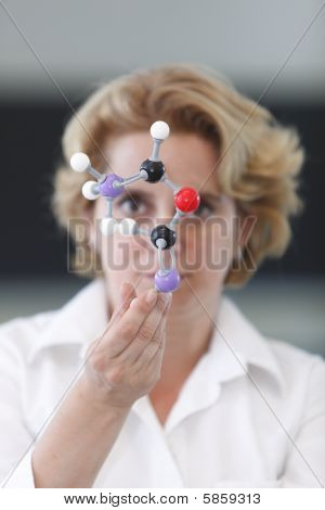Female Researcher Analyzing A Molecular Structure