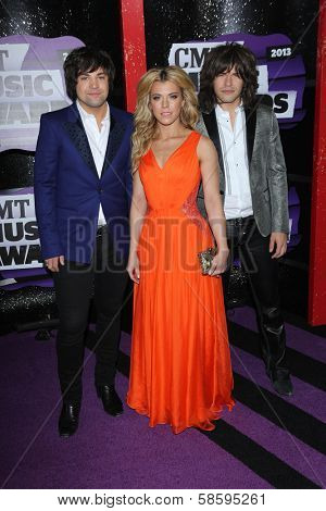 Reid Perry, Kimberly Perry, Neil Perry at the 2013 CMT Music Awards, Bridgestone Arena, Nashville, TN 06-05-13