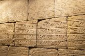 stock photo of hieroglyphs  - Egyptian hieroglyphics on the stone wall, traditional
