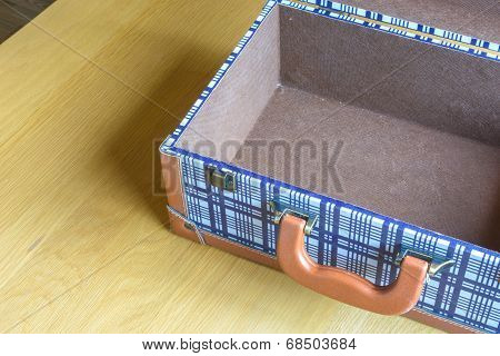 Open Baggage On Wooden Table