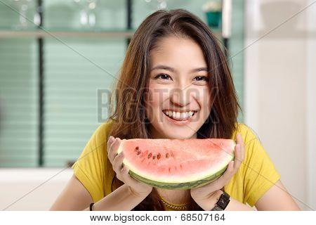 Young Asian Cute Woman Eating Watermelon