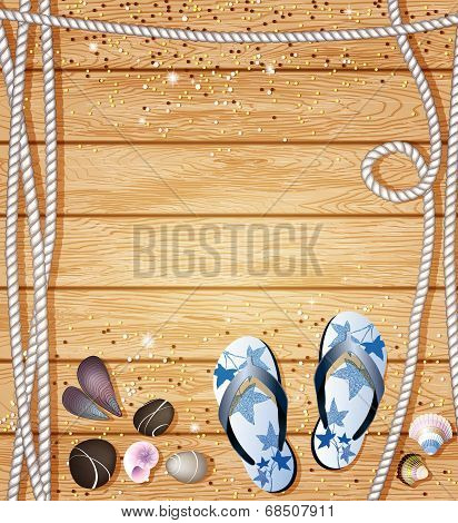 Flip-Flops, pebbles, sea shells and ropes on wooden background