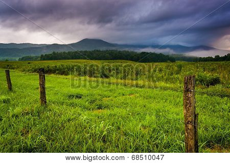 Fence In A Field And Low Clouds Over Mountains At Cade's Cove, Great Smoky Mountains National Park,