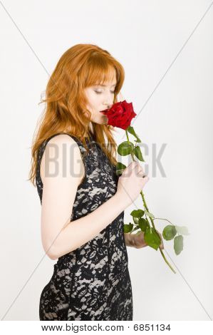 Beautiful elegant woman with red rose
