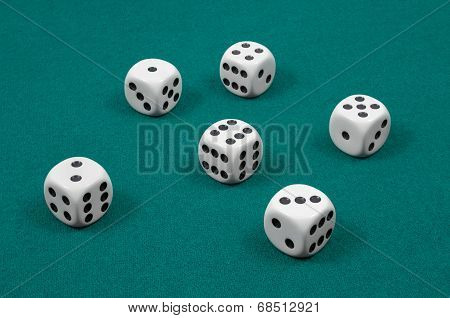 White Dice On Green Felt