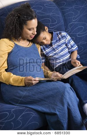 Mother Reading Book To Son