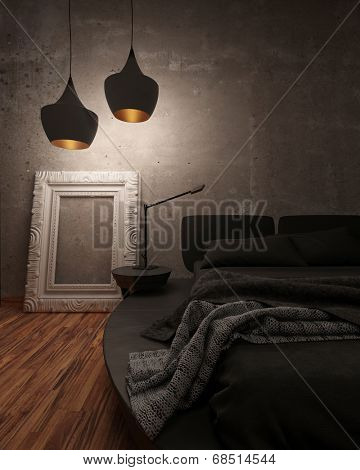 Black leather bed with padded headboard and throw rug illuminated at night by two modern hanging lights in a shadowy room, closeup partial view of the bed