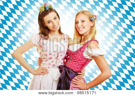 Two smiling women in pink dirndl dress in Bavaria