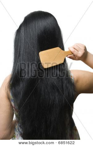 Woman Brushing Her Black Long Hair