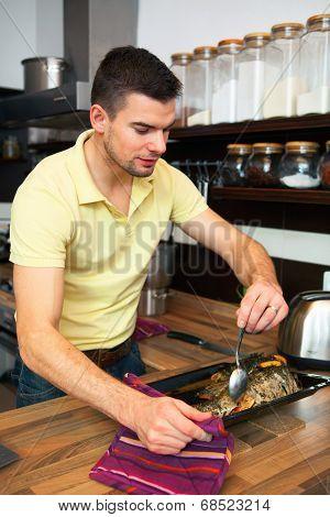 Young Handsome Man Preparing Fish