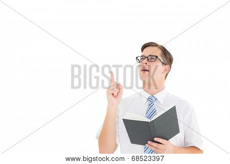 Geeky businessman reading from book on white background