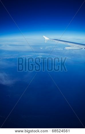 Airplane flying high above the Earth