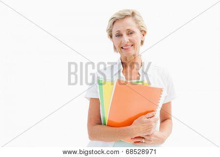 Happy mature student holding notebooks on white background