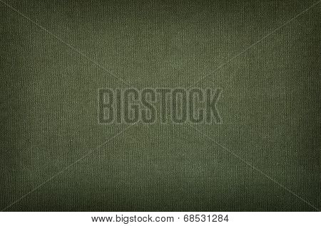 Olive green cotton texture with a vignette