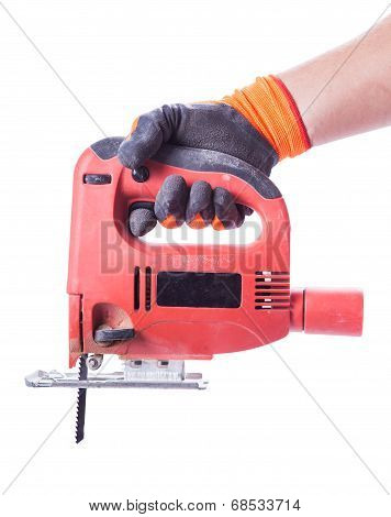 Man's Hand In A Glove Holds A Working Jig Saw