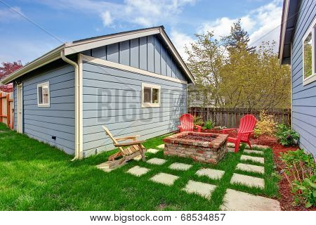Backyard With Fire Pit And Deck Chairs