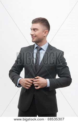 Closeup portrait of young handsome businessman in suit