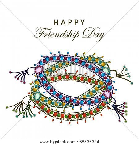 Colorful wristbands on white background for Happy Friendship Day celebrations.