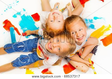Three funny girls sitting on a floor