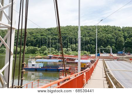 Tug Boat Sets Section Of The Pontoon Bridge