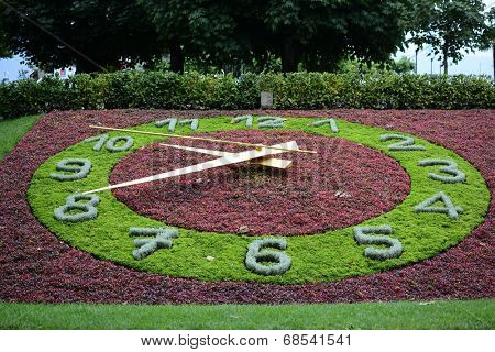 LAUSANNE-OUCHY, SWITZERLAND - JULY 9, 2014: The Floral Clock in Ouchy a district of Lausanne. The flower clock, in a park near the port, is symbolic of Switzerland's renown in the timekeeping industry