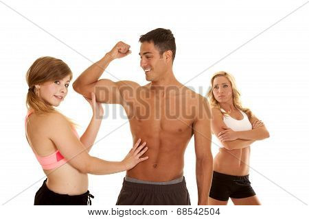 Fitness Man With Two Women One Mad Arms Folded