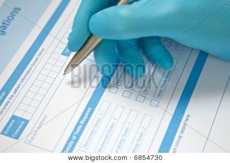 Doctor Completing Blood Test Form