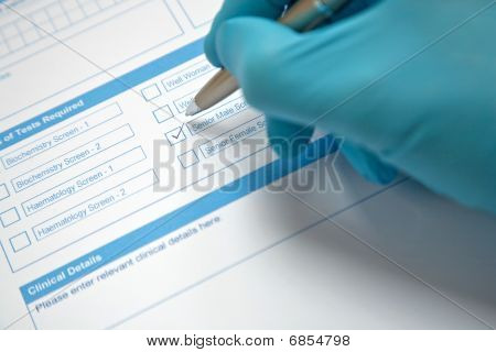 Doctor Completing Pathology Request Form