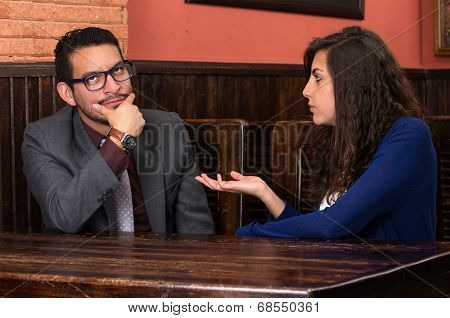 young latin couple in a restaurant