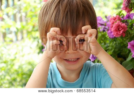 Boy Making Glasses With Hands
