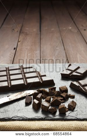 Pieces Of Chocolate On Slate Plate With Copy Space