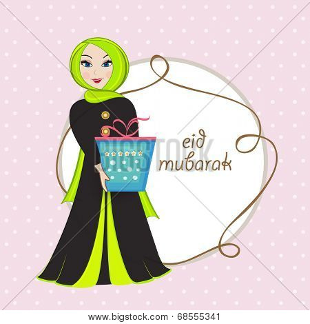 Cute religious muslim girl holding gift boxes on occasion of Eid Mubarak celebrations.