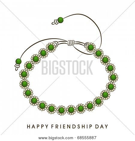 Green pearl decorated friendship band on white background for Happy Friendship Day celebrations.