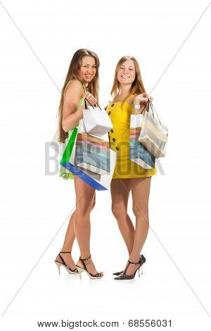 Shopping. Two beautiful girl with bag