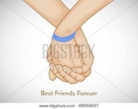Happy Friendship Day celebrations concept with young human hands holding each other on shiny grey background.