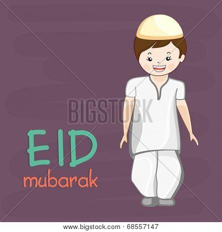 Cute muslim boy in traditional outfits for the celebration of muslim community festival Eid Mubarak.