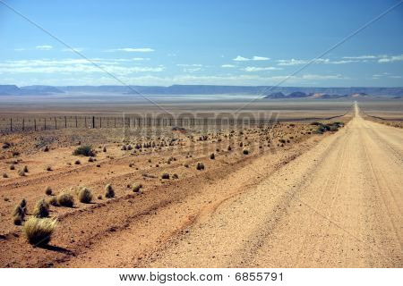 Namibian Dirt Road Heading Into The Distance