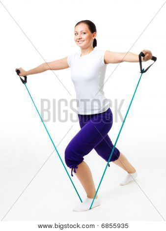 Young Woman Doing Fitness With Expander