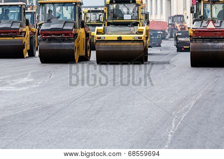 Heavy Steam Rollers Paving A Road