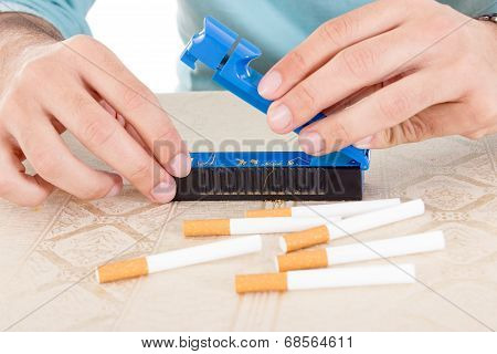 Preparing Handmade Cigarettes Using Rollings And Tobacco