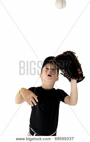 Young Boy Baseball Player Focused On Catching The Baseball