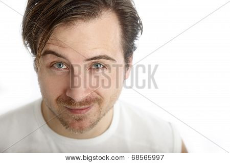 Attractive Man In A White Shirt Looks Into The Camera