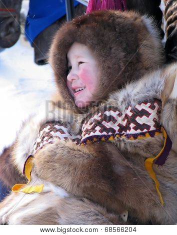 Nadym, Russia - March 11, 2005:  Unknown Boy Nenets On The Snowmobile.