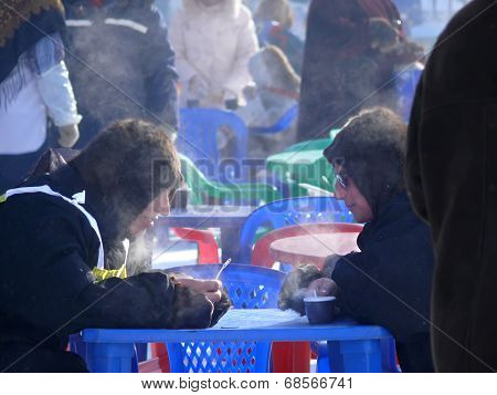 Nadym, Russia - March 15, 2008: Street Cafe. Unknown Men Nenets, Drinking Tea At The Table And Talk.